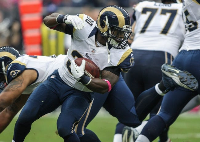 Oct 13, 2013; Houston, TX, USA; St. Louis Rams running back Zac Stacy (30) rushes during the third quarter against the Houston Texans at Reliant Stadium. Mandatory Credit: Troy Taormina-USA TODAY Sports