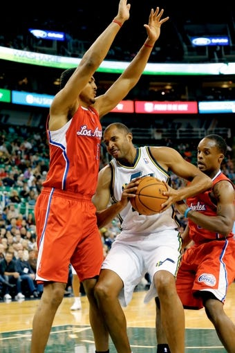 Oct 12, 2013; Salt Lake City, UT, USA; Utah Jazz power forward Brian Cook (44) tries to get around Los Angeles Clippers center Ryan Hollins (15) during the fourth quarter at EnergySolutions Arena. The Los Angeles Clippers won 106-74.  Mandatory Credit: Chris Nicoll-USA TODAY Sports
