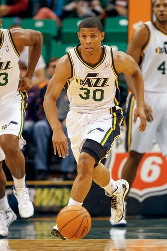 Oct 12, 2013; Salt Lake City, UT, USA; Utah Jazz point guard Scott Machado (30) brings the ball up the court during the fourth quarter at EnergySolutions Arena. The Los Angeles Clippers won 106-74.  Mandatory Credit: Chris Nicoll-USA TODAY Sports