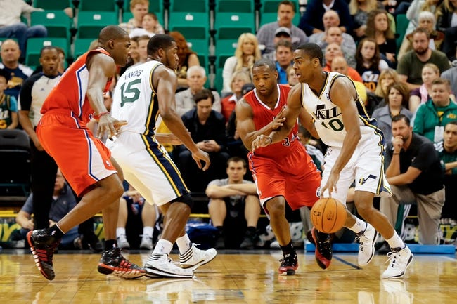 Oct 12, 2013; Salt Lake City, UT, USA; Utah Jazz point guard Alec Burks (10) tries to dribble past Los Angeles Clippers shooting guard Willie Green (34) during the first quarter at EnergySolutions Arena. The Los Angeles Clippers won 106-74.  Mandatory Credit: Chris Nicoll-USA TODAY Sports
