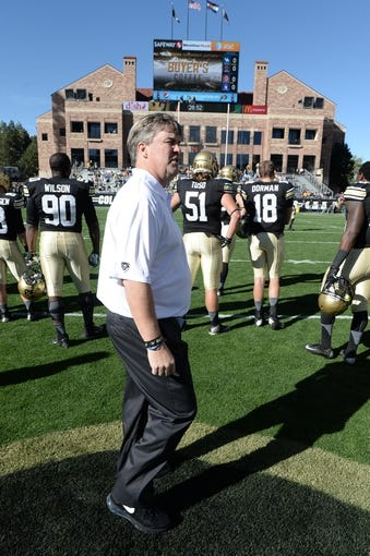Oct 5, 2013; Boulder, CO, USA; Colorado Buffaloes head coach Mike Macintyre walks the field before the start of the game against the Oregon Ducks at Folsom Field. Mandatory Credit: Ron Chenoy-USA TODAY Sports
