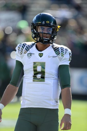 Oct 5, 2013; Boulder, CO, USA; Oregon Ducks quarterback Marcus Mariota (8) before the game against the Colorado Buffaloes at Folsom Field. Mandatory Credit: Ron Chenoy-USA TODAY Sports