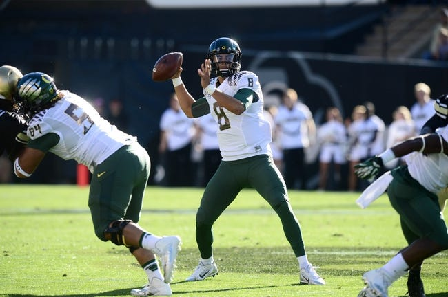Oct 5, 2013; Boulder, CO, USA; Oregon Ducks quarterback Marcus Mariota (8) prepares to pass in the first quarter against the Colorado Buffaloes at Folsom Field. Mandatory Credit: Ron Chenoy-USA TODAY Sports