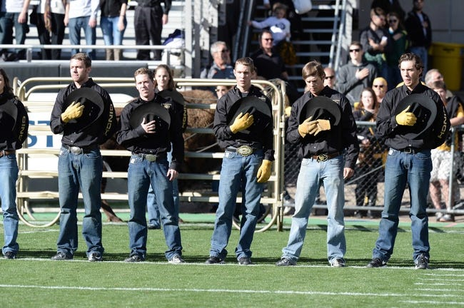 Oct 5, 2013; Boulder, CO, USA; Colorado Buffaloes mascot wranglers during the national anthem before the game against the Oregon Ducks at Folsom Field. Mandatory Credit: Ron Chenoy-USA TODAY Sports