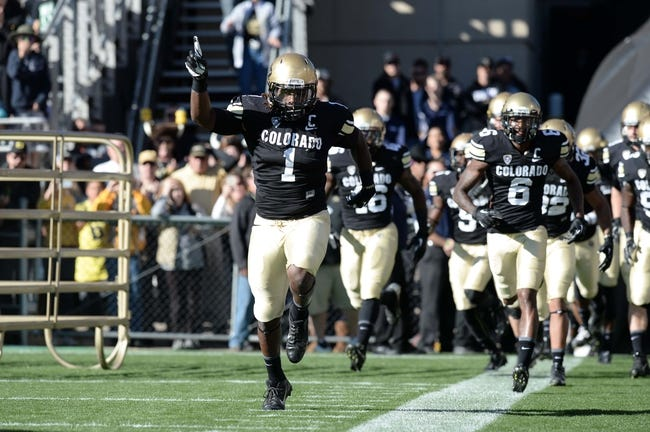 Oct 5, 2013; Boulder, CO, USA; Colorado Buffaloes linebacker Derrick Webb (1) runs out onto the field followed by teammates before the game against the Oregon Ducks at Folsom Field. Mandatory Credit: Ron Chenoy-USA TODAY Sports