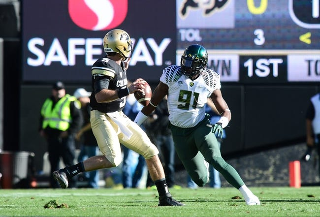 Oct 5, 2013; Boulder, CO, USA; Oregon Ducks defensive end Tony Washington (91) defends against Colorado Buffaloes quarterback Connor Wood (5) in the first quarter at Folsom Field. Mandatory Credit: Ron Chenoy-USA TODAY Sports