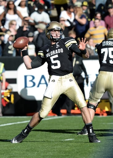 Oct 5, 2013; Boulder, CO, USA; Colorado Buffaloes quarterback Connor Wood (5) prepares to pass in the first quarter against the Oregon Ducks at Folsom Field. Mandatory Credit: Ron Chenoy-USA TODAY Sports