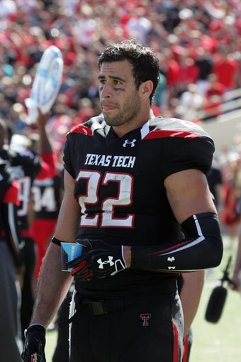 Oct 12, 2013; Lubbock, TX, USA; Texas Tech Red Raiders tight end Jace Amaro (22) on the sidelines during the game with the Iowa State Cyclones at Jones AT&T Stadium. Mandatory Credit: Michael C. Johnson-USA TODAY Sports
