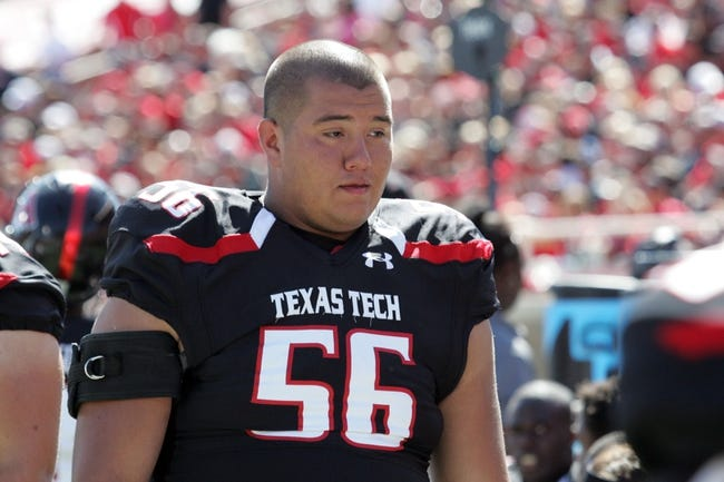 Oct 12, 2013; Lubbock, TX, USA; Texas Tech Red Raiders offensive lineman Alfredo Morales (56) on the sidelines in the game with the Iowa State Cyclones at Jones AT&T Stadium. Mandatory Credit: Michael C. Johnson-USA TODAY Sports
