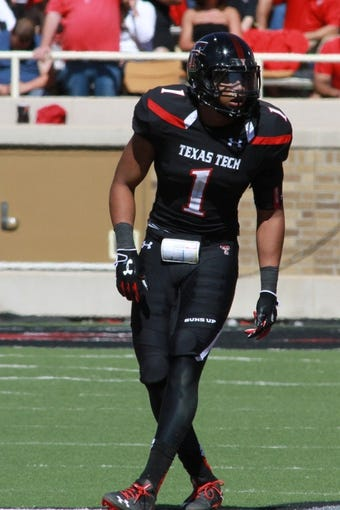 Oct 12, 2013; Lubbock, TX, USA; Texas Tech Red Raiders linebacker Terrance Bullitt (1) during the second half in the game with the Iowa State Cyclones at Jones AT&T Stadium. Mandatory Credit: Michael C. Johnson-USA TODAY Sports