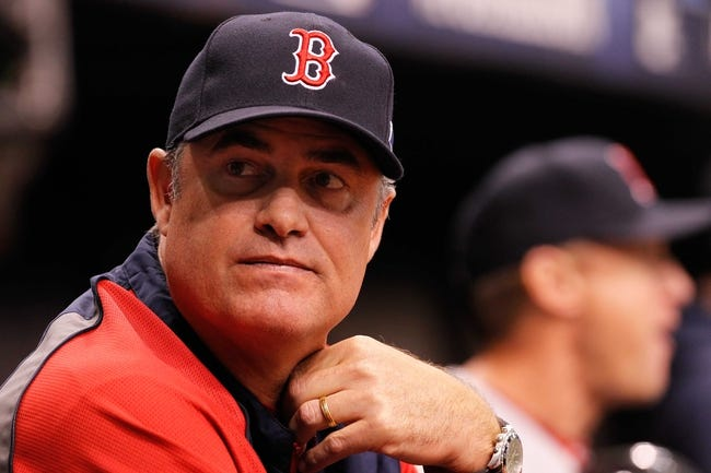 Oct 7, 2013; St. Petersburg, FL, USA; Boston Red Sox manager John Farrell (53) in the dugout against the Tampa Bay Rays during the first inning of game three of the American League divisional series at Tropicana Field. Mandatory Credit: Kim Klement-USA TODAY Sports
