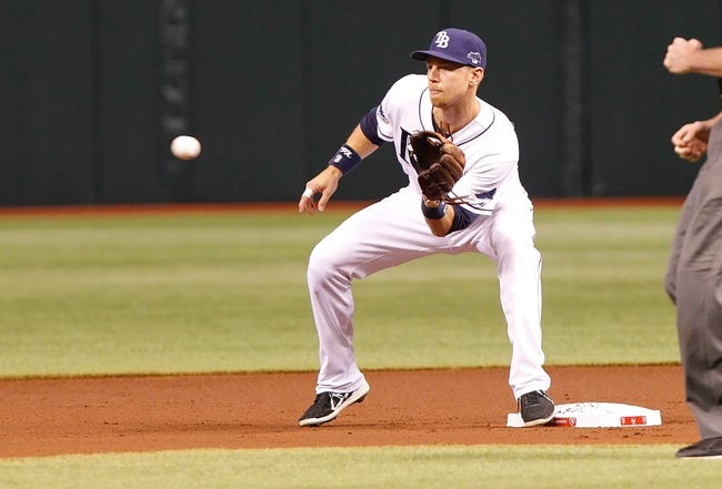 Oct 7, 2013; St. Petersburg, FL, USA; Tampa Bay Rays second baseman Ben Zobrist (18) catches the ball at second base against the Boston Red Sox during the first inning of game three of the American League divisional series at Tropicana Field. Mandatory Credit: Kim Klement-USA TODAY Sports