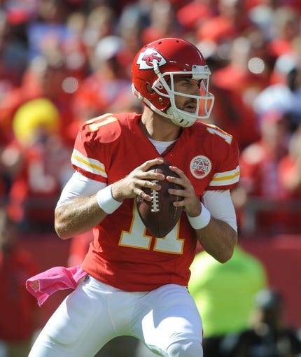 Oct 13, 2013; Kansas City, MO, USA; Kansas City Chiefs quarterback Alex Smith (11) passes the ball during the first half of the game against the Oakland Raiders at Arrowhead Stadium. The Chiefs won 24-7. Mandatory Credit: Denny Medley-USA TODAY Sports