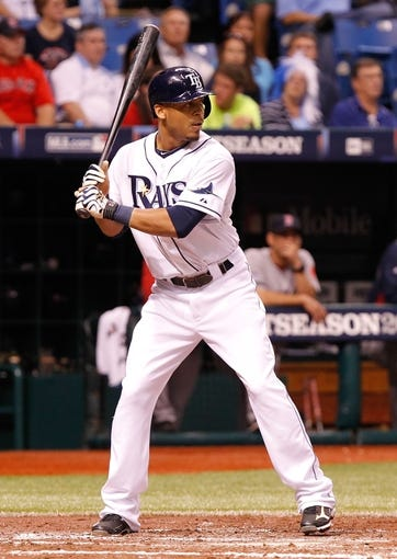 Oct 7, 2013; St. Petersburg, FL, USA; Tampa Bay Rays center fielder Desmond Jennings (8) at bat against the Boston Red Sox of game three of the American League divisional series at Tropicana Field. Mandatory Credit: Kim Klement-USA TODAY Sports