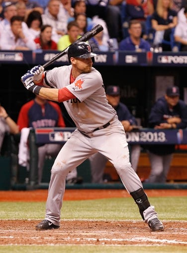 Oct 7, 2013; St. Petersburg, FL, USA; Boston Red Sox third baseman Will Middlebrooks (16) at bat against the Tampa Bay Rays of game three of the American League divisional series at Tropicana Field. Mandatory Credit: Kim Klement-USA TODAY Sports