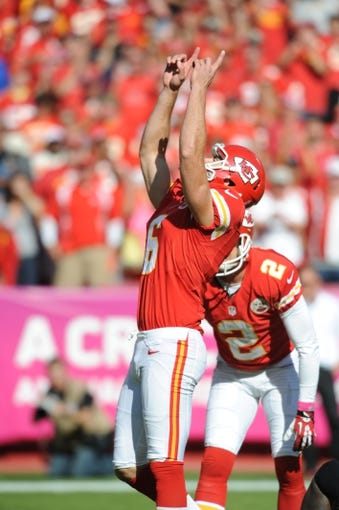 Oct 13, 2013; Kansas City, MO, USA; Kansas City Chiefs kicker Ryan Succop (6) celebrates after kicking a point after during the second half of the game against the Oakland Raiders at Arrowhead Stadium. The Chiefs won 24-7. Mandatory Credit: Denny Medley-USA TODAY Sports