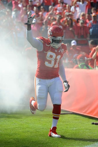 Oct 13, 2013; Kansas City, MO, USA; Kansas City Chiefs outside linebacker Tamba Hali (91) is introduced before the game against the Oakland Raiders at Arrowhead Stadium. The Chiefs won 24-7. Mandatory Credit: Denny Medley-USA TODAY Sports
