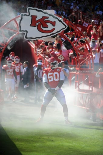 Oct 13, 2013; Kansas City, MO, USA; Kansas City Chiefs outside linebacker Justin Houston (50) is introduced before the game against the Oakland Raiders at Arrowhead Stadium. The Chiefs won 24-7. Mandatory Credit: Denny Medley-USA TODAY Sports