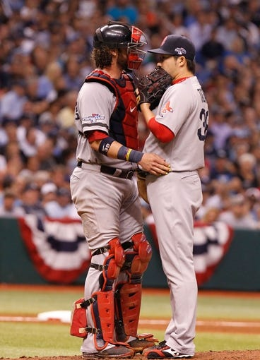 Oct 7, 2013; St. Petersburg, FL, USA; Boston Red Sox relief pitcher Junichi Tazawa (36) talks with catcher Jarrod Saltalamacchia (39) on the mound against the Tampa Bay Rays of game three of the American League divisional series at Tropicana Field. Mandatory Credit: Kim Klement-USA TODAY Sports