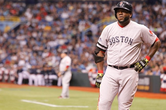 Oct 7, 2013; St. Petersburg, FL, USA; Boston Red Sox designated hitter David Ortiz (34) at bat against the Tampa Bay Rays during the first inning of game three of the American League divisional series at Tropicana Field. Mandatory Credit: Kim Klement-USA TODAY Sports