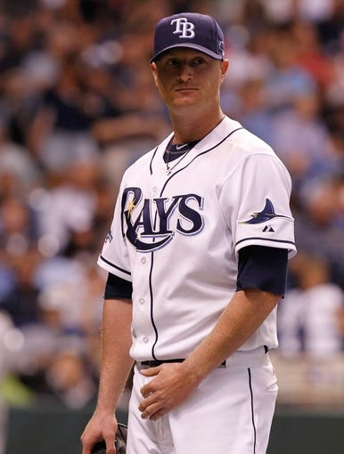 Oct 7, 2013; St. Petersburg, FL, USA; Tampa Bay Rays starting pitcher Alex Cobb (53) walks back to the dugout against the Boston Red Sox of game three of the American League divisional series at Tropicana Field. Mandatory Credit: Kim Klement-USA TODAY Sports