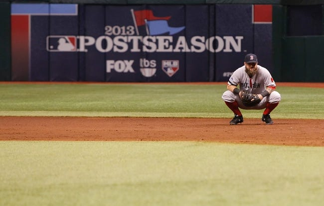 Oct 7, 2013; St. Petersburg, FL, USA; Boston Red Sox first baseman Mike Napoli (12) during the first inning of game three of the American League divisional series against the Tampa Bay Rays at Tropicana Field. Mandatory Credit: Kim Klement-USA TODAY Sports