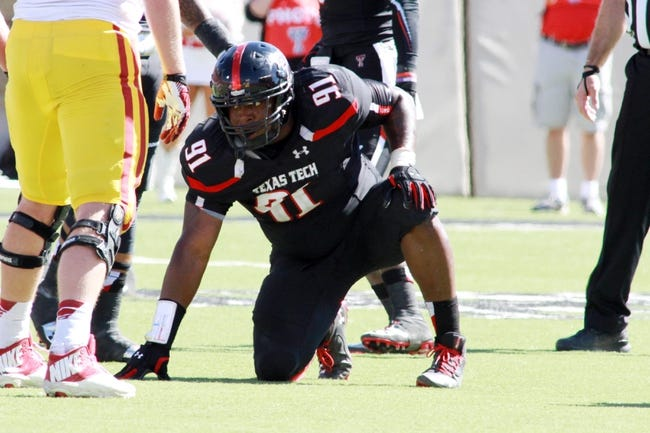 Oct 12, 2013; Lubbock, TX, USA; Texas Tech Red Raiders defensive lineman Kerry Hyder (91) in the second half in the game with the Iowa State Cyclones at Jones AT&T Stadium. Mandatory Credit: Michael C. Johnson-USA TODAY Sports