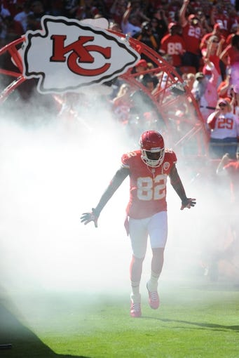 Oct 13, 2013; Kansas City, MO, USA; Kansas City Chiefs wide receiver Dwayne Bowe (82) is introduced before the game against the Oakland Raiders at Arrowhead Stadium. The Chiefs won 24-7. Mandatory Credit: Denny Medley-USA TODAY Sports
