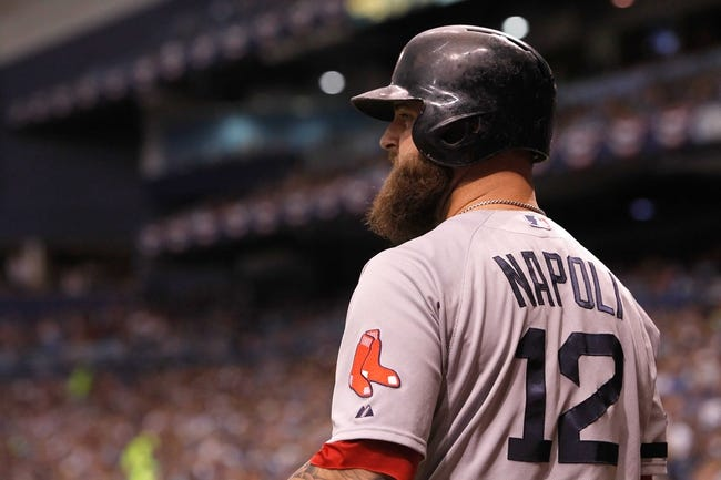 Oct 7, 2013; St. Petersburg, FL, USA; Boston Red Sox first baseman Mike Napoli (12) at bat during the first inning of game three of the American League divisional series against the Tampa Bay Rays at Tropicana Field. Mandatory Credit: Kim Klement-USA TODAY Sports