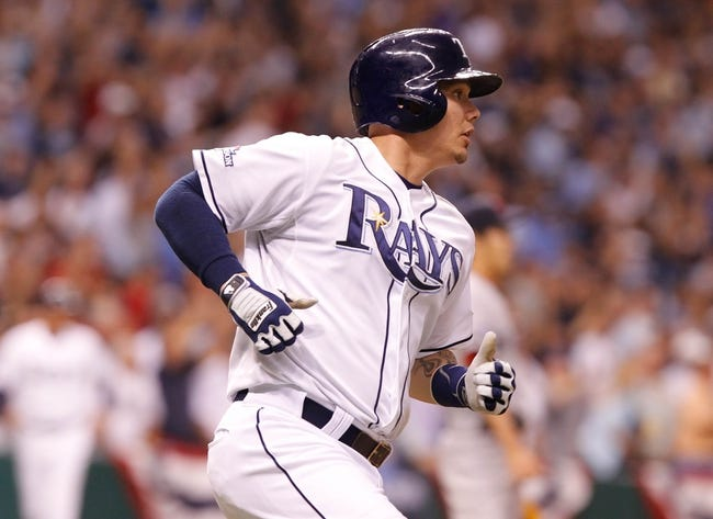 Oct 7, 2013; St. Petersburg, FL, USA; Tampa Bay Rays catcher Jose Lobaton (59) hits a walk off home run during the ninth inning against the Boston Red Sox of game three of the American League divisional series at Tropicana Field. Tampa Bay Rays defeated the Boston Red Sox 5-4. Mandatory Credit: Kim Klement-USA TODAY Sports