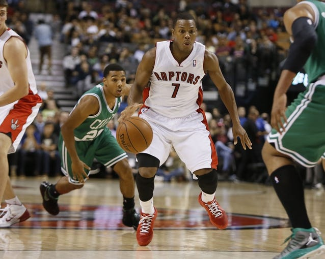 Oct 16, 2013; Toronto, Ontario, CAN; Toronto Raptors guard Kyle Lowry (7) carries the ball as Boston Celtics guard Phil Pressey (26) chases during the first half at Air Canada Centre. Mandatory Credit: John E. Sokolowski-USA TODAY Sports
