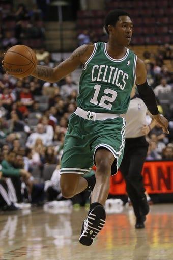 Oct 16, 2013; Toronto, Ontario, CAN; Boston Celtics guard-forward MarShon Brooks (12) dribbles the ball against the Toronto Raptors at Air Canada Centre. Toronto defeated Boston 99-97. Mandatory Credit: John E. Sokolowski-USA TODAY Sports