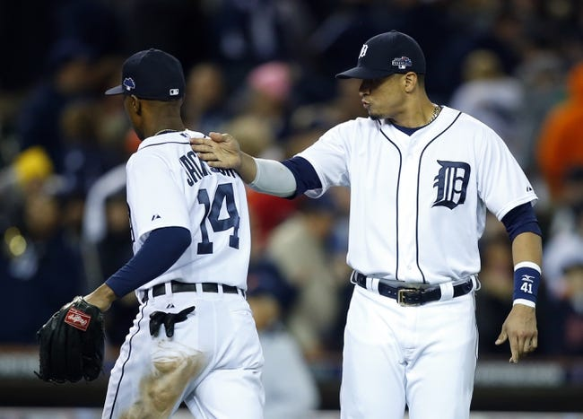 Oct 16, 2013; Detroit, MI, USA;  Detroit Tigers designated hitter Victor Martinez (right) celebrates with Detroit Tigers center fielder Austin Jackson (14) after defeating the Boston Red Sox 7-3 in game four of the American League Championship Series baseball game at Comerica Park. Mandatory Credit: Rick Osentoski-USA TODAY Sports