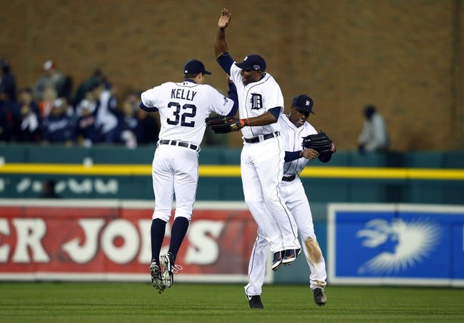 Oct 16, 2013; Detroit, MI, USA; Detroit Tigers left fielder Don Kelly (32), right fielder Torii Hunter (center) and center fielder Austin Jackson (right) celebrate after defeating the Boston Red Sox 7-3 in game four of the American League Championship Series baseball game at Comerica Park. Mandatory Credit: Rick Osentoski-USA TODAY Sports