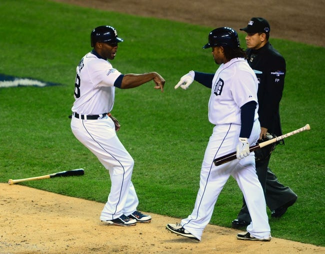 Oct 16, 2013; Detroit, MI, USA; Detroit Tigers right fielder Torii Hunter (48) celebrates with first baseman Prince Fielder (28) after scoring against the Boston Red Sox during the second inning in game four of the American League Championship Series baseball game at Comerica Park. Mandatory Credit: Andrew Weber-USA TODAY Sports