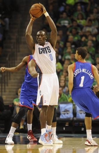 Oct 17, 2013; Charlotte, NC, USA; Charlotte Bobcats forward Bismack Biyombo (0) looks to pass during the pre season game against the Philadelphia 76ers at Time Warner Cable Arena. Mandatory Credit: Sam Sharpe-USA TODAY Sports