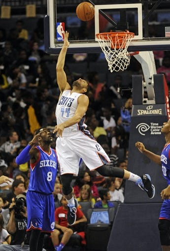 Oct 17, 2013; Charlotte, NC, USA; Charlotte Bobcats forward Jeffery Taylor (44) drives to the basket and scores during the pre season game against the Philadelphia 76ers at Time Warner Cable Arena. Mandatory Credit: Sam Sharpe-USA TODAY Sports