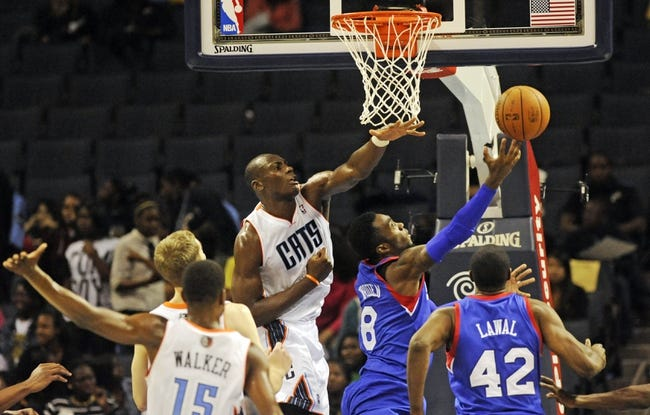 Oct 17, 2013; Charlotte, NC, USA; Philadelphia 76ers guard Tony Wroten (8) drives to the basket as he is defended by Charlotte Bobcats forward center Bismack Biyombo (0) during the pre season game at Time Warner Cable Arena. Bobcats win 110-84. Mandatory Credit: Sam Sharpe-USA TODAY Sports