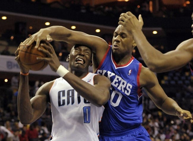 Oct 17, 2013; Charlotte, NC, USA; Charlotte Bobcats forward Bismack Biyombo (0) looks to shoot as he is defended by Philadelphia 76ers forward guard Lavoy Allen (50) during the pre season game at Time Warner Cable Arena. Bobcats win 110-84. Mandatory Credit: Sam Sharpe-USA TODAY Sports