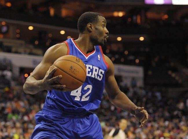 Oct 17, 2013; Charlotte, NC, USA; Philadelphia 76ers forward Gani Lawal (42) looks to pass the ball during the pre season game against the Charlotte Bobcats at Time Warner Cable Arena. Bobcats win 110-84. Mandatory Credit: Sam Sharpe-USA TODAY Sports