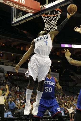 Oct 17, 2013; Charlotte, NC, USA; Charlotte Bobcats forward Jeff Adrien (4) drives to the basket and scores during the pre season game against the Philadelphia 76ers at Time Warner Cable Arena. Bobcats win 110-84. Mandatory Credit: Sam Sharpe-USA TODAY Sports