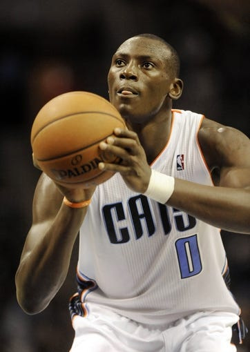 Oct 17, 2013; Charlotte, NC, USA; Charlotte Bobcats forward Bismack Biyombo (0) shoots a foul shot during the pre season game against the Philadelphia 76ers at Time Warner Cable Arena. Bobcats win 110-84. Mandatory Credit: Sam Sharpe-USA TODAY Sports