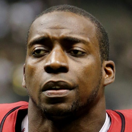 Sep 22, 2013; New Orleans, LA, USA; Arizona Cardinals running back Rashard Mendenhall (28) walks off the field at the conclusion of their game against the New Orleans Saints at Mercedes-Benz Superdome. Mandatory Credit: Chuck Cook-USA TODAY Sports