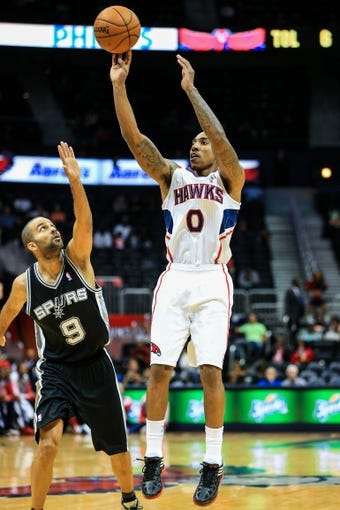 Oct 17, 2013; Atlanta, GA, USA; Atlanta Hawks point guard Jeff Teague (0) shoots a basket in the first half against the San Antonio Spurs at Philips Arena. Mandatory Credit: Daniel Shirey-USA TODAY Sports