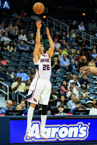 Oct 17, 2013; Atlanta, GA, USA; Atlanta Hawks shooting guard Kyle Korver (26) shoots a three in the first half against the San Antonio Spurs at Philips Arena. Mandatory Credit: Daniel Shirey-USA TODAY Sports