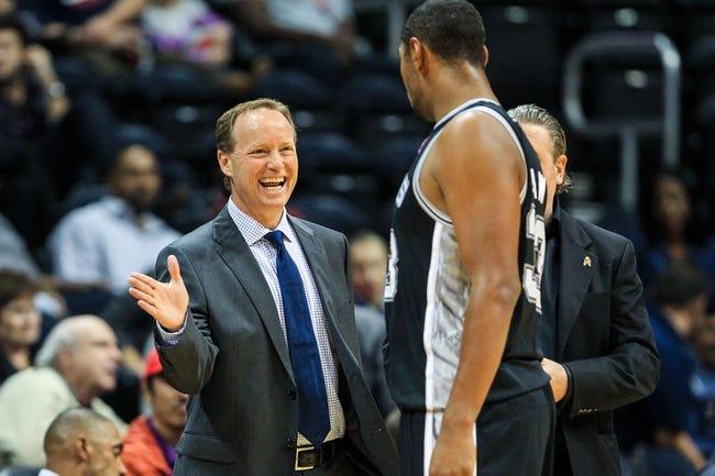 Oct 17, 2013; Atlanta, GA, USA; Atlanta Hawks head coach Mike Budenholzer talks to San Antonio Spurs power forward Boris Diaw (33) in the first half at Philips Arena. Mandatory Credit: Daniel Shirey-USA TODAY Sports