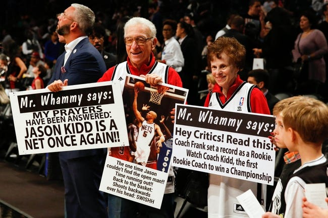Oct 17, 2013; Brooklyn, NY, USA;  Bruce Reznick aka Mr Whammy displays his game signs before the game against the Miami Heat at Barclays Center. Mandatory Credit: Anthony Gruppuso-USA TODAY Sports