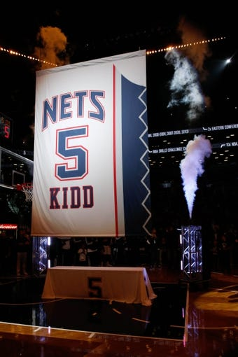 Oct 17, 2013; Brooklyn, NY, USA;  Brooklyn Nets head coach Jason Kidd jersey number rises in retirement at Barclays Center before the game against the Miami Heat. Mandatory Credit: Anthony Gruppuso-USA TODAY Sports