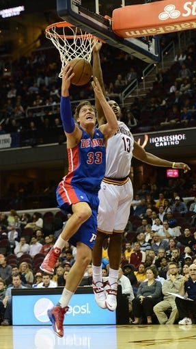 Oct 17, 2013; Cleveland, OH, USA; Detroit Pistons power forward Jonas Jerebko (33) drives to the basket as Cleveland Cavaliers power forward Tristan Thompson (13) defends during the game at Quicken Loans Arena. Mandatory Credit: Eric P. Mull-USA TODAY Sports
