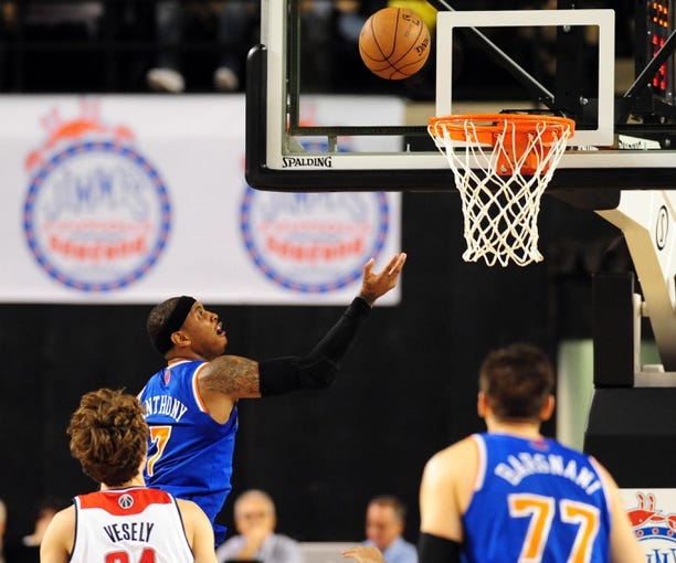 Oct 17, 2013; Baltimore, MD, USA; New York Knicks forward Carmelo Anthony (7) lays the ball up in the first quarter against the Washington Wizards at Baltimore Arena. Mandatory Credit: Evan Habeeb-USA TODAY Sports